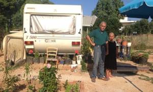 Georgios Karvouniaris and his sister Barbara outside their caravan