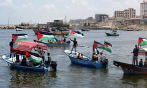 Palestinians at a rally to support the flotilla at Gaza City on 24 June.