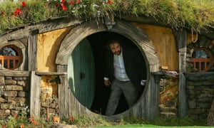 Peter Jackson leaving a Hobbit House in 2012.