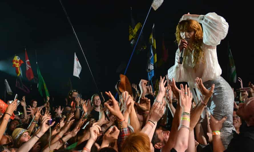 Florence Welch gets close to the Glastonbury crowd.