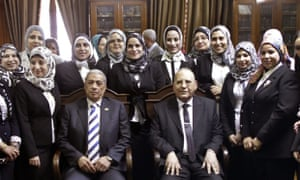 Hisham Barakat (seated left), at the high court in Cairo with a group of newly appointed female judges earlier this month.