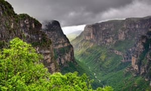 Rain and cloud over the Vikos Gorge from the Oxia viewpoint, Zagoria, Epirus, Greece,