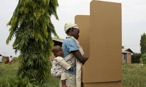 A woman votes at a polling station in Kinama neighbourhood near Bujumbura in Burundi on 29 June. There have been reports of a low turnout.