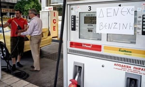 A notice at a petrol station in Athens reads 'NO Fuel'.