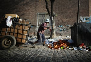 A man pulls a cart with recyclables he has collected to exchange for money near the Virgin of the Miracles of Caacupe church following Sunday Mass in the Villa 21-24 slum