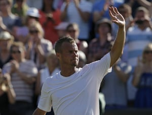 Lleyton Hewitt waves goodbye to Wimbledon.