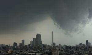 A storm hangs over Tokyo, August 2013.