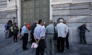 People wait outside a closed National Bank of Greece branch in Athens.