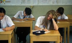 Schools pupils taking exams.