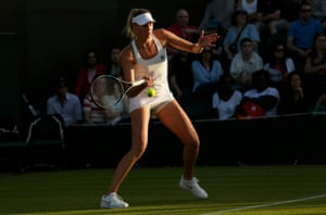 Naomi Broady returns the ball in her defeat to Mariana Duque-Mariono.