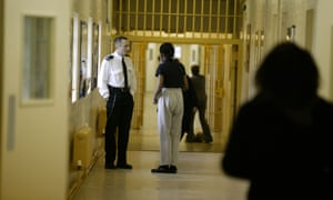 A warden talks to a prisoner at Brockhill women's prison in Redditch, Worcestershire. Prison governors now have a duty to prevent extremist radicalisation occurring.