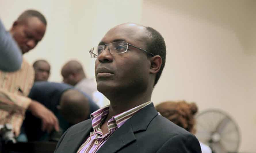 Journalist Rafael Marques de Morais sits in court in Luanda where he was given a six-month suspended sentence after being convicted of slander.