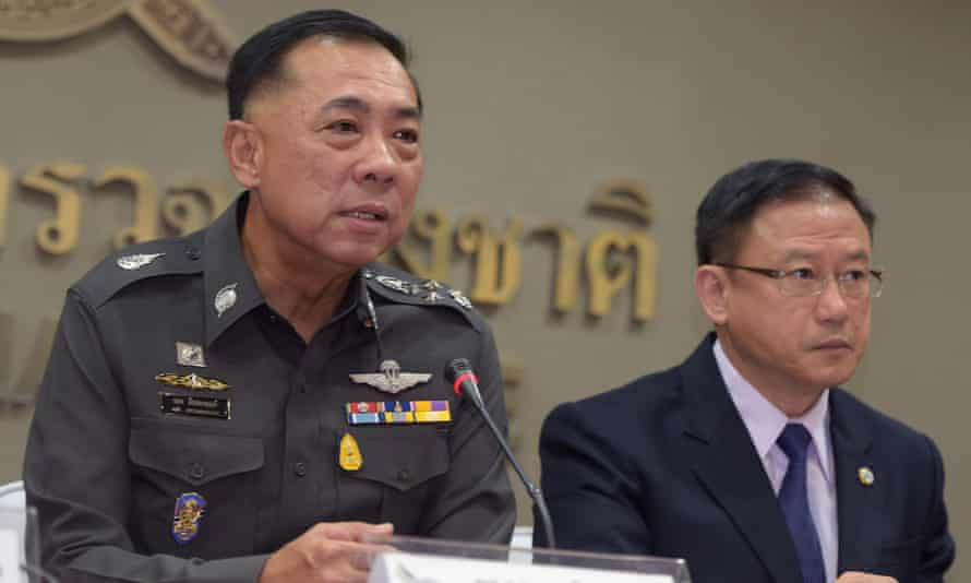 Thai police General Aek Angsananont, left, gives a press conference on the country's anti-trafficking operations.