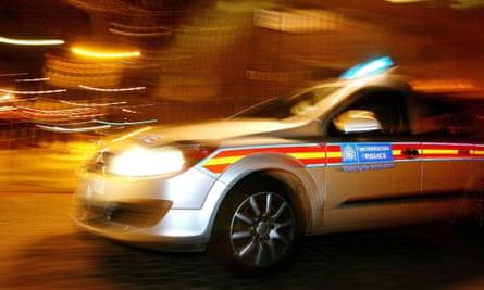 police car on a 'blues-and-twos' run