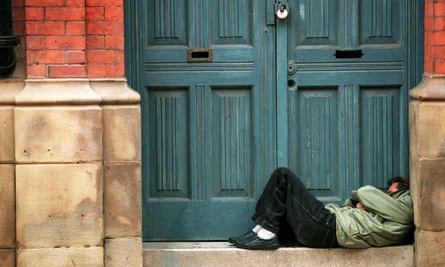 Homeless man sleeping in a doorway