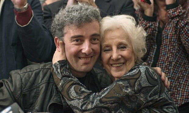 'I begged God not to let me die before I found him': Estela Carlotto hugs her grandson Ignacio Montoya Carlotto, son of her daughter Laura, who 'disappeared' in 1977. Photograph: Leo La Valle/Getty