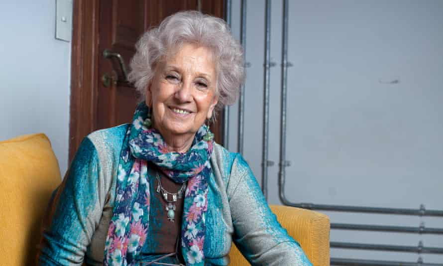 Estela Carlotto sitting on a sofa, smiling