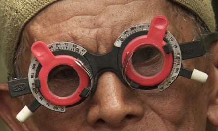 Adi Rukun tests the eyes of one of the men who killed his brother.