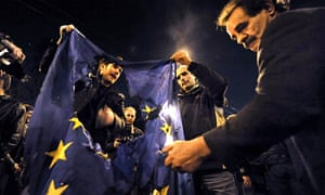 Greek protesters burn an EU flag