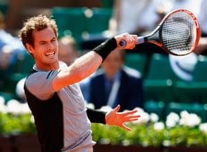 Andy Murray returns.