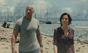 """""""Very entertaining but rather scientifically unrealistic"""" ... Dwayne Johnson and Carla Gugino in San Andreas."""
