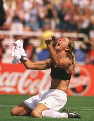 Brandi Chastain of the US celebrates and takes her shirt off after scoring with the decisive penalty against China in the World Cup Final in July 1999.
