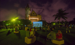 An audience watches a video installation outside Frere Hall in central Karachi, April 2015.
