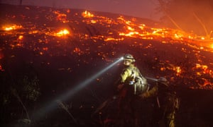 U.S. Forest Service firefighters from Leavenworth cut brush near houses in northern Wenatchee, Washington.