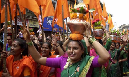 Nashik 2003: Hindu women devotees carry brass pots to make an offering in the River Godavari on the first day of the month-long Kumbh Mela