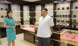 """Kim Jong-un was photographed inspecting the duty free shops of the new terminal with his wife, former singer <a href=""""http://www.theguardian.com/world/2012/oct/30/ri-sol-ju-pass-notes"""">Ri Sol-ju</a>"""