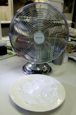 A  fan blowing air over ice cubes