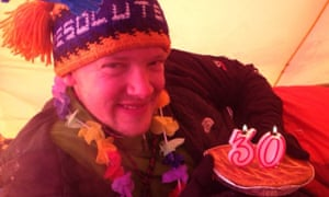 Philip, with a cake and candles in the tent, celebrates his 30th birthday.