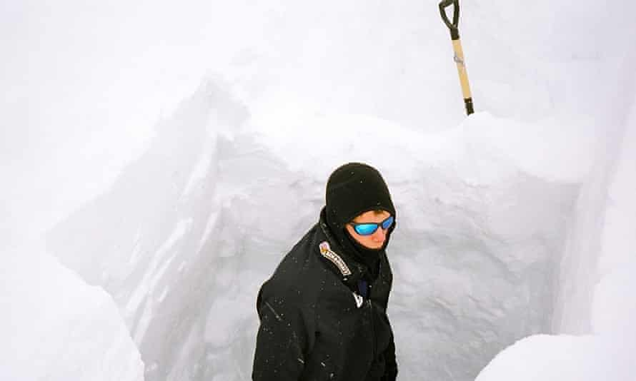 Philip de Roo digs into the ice in Greenland