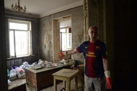 Murman Chanturashvili clears debris from his ground-floor flat on Svanidze Street.