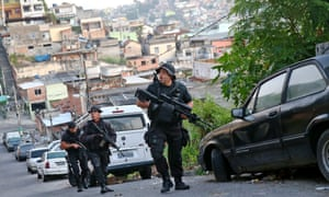 Officers from the CORE police special forces patrol during an operation to search for fugitives in a favela in Rio de Janeiro, Brazil.