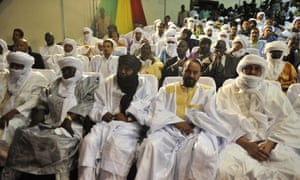 Representatives of the Azawad Movement attend the signing of the ammended version of the Algerian Accord on June 20, 2015 in Bamako. Mali's Tuareg-led rebel alliance signed the landmark deal to end years of unrest in a nation riven by ethnic divisions and in the grip of a jihadist insurgency. The document had already been signed in May by the Malian government and loyalist militias but the Coordination of Azawad Movements (CMA), a coalition of rebel groups, had been holding out until amendments were agreed two weeks ago.