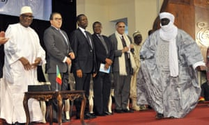 Mahamadou Djery Maiga (R), the vice-president and spokesman of the Transitional Council of the State of Azawad walks towards Mali's President Ibrahim Boubacar Keita (L), following the signing of the ammended version of the Algerian Accord on June 20, 2015 in Bamako. Mali's Tuareg-led rebel alliance signed the landmark deal to end years of unrest in a nation riven by ethnic divisions and in the grip of a jihadist insurgency.