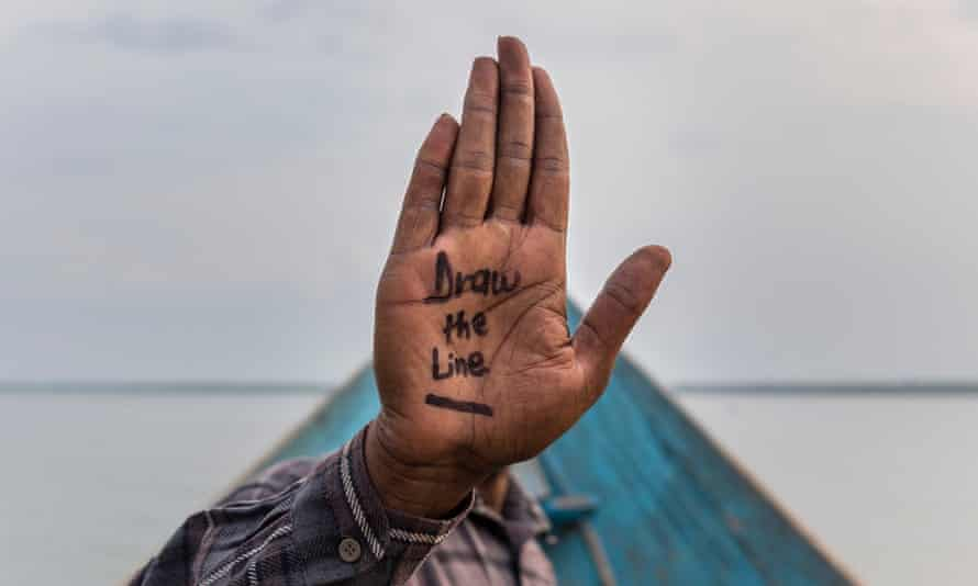 A villager who objects to any oil prospecting and drilling posing in an undisclosed location as part of the Draw the Line, Save Virunga National Park campaign