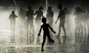 Children play as they cool down in a fountain beside Manzanares river in Madrid,  Spain, Monday, June 29, 2015. Weather stations across Spain are warning people to take extra precautions as a heat wave engulfs much of the country