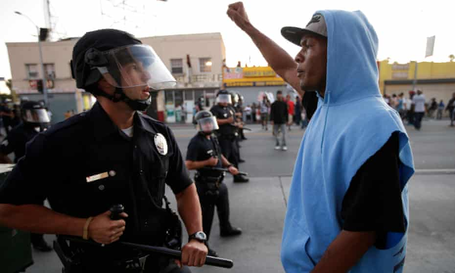 A protester confronts the police after the acquittal of Trayvon Martin's killer in 2013.