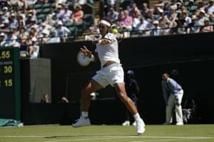 Nadal smashes a forehand return.