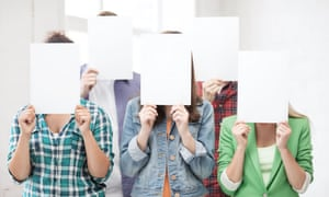 students holding paper in front of their faces