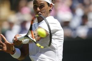 Rafael Nadal returns.