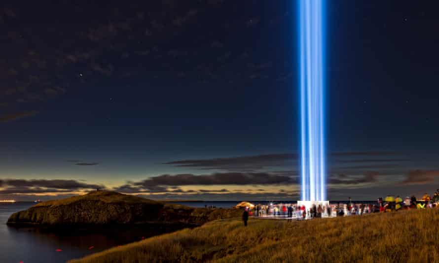 The annually lit Imagine Peace Tower, a memorial in Reykjavik, Iceland to John Lennon by Yoko Ono made of searchlights with prisms and containing the words 'Imagine Peace' carved in 24 languages as well as 1 million written wishes from her Wish Trees project
