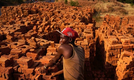 A worker stacks bricks in Kabezi, Burundi.
