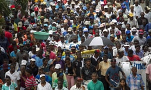 Haitian sugar cane workers march towards the constitutional court where they have lodged an appeal to prevent being deported after working all their life in the sugar cane fields of the Dominican Republic