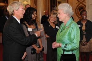 Queen Elizabeth II receiving Blue Peter presenter John Noakes in 2008