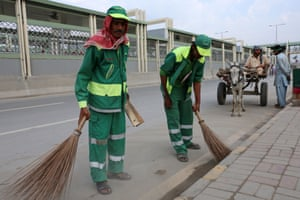 Road cleaning and waste disposal in is carried out by Christian workers in Lahore, Pakistan, 13 April 2014.