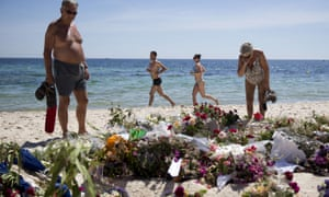 Floral tributes have been placed where the attack started on the beach.