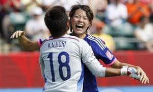 Japan's Saki Kumagai and Ayumi Kaihori celebrate their victory over Australia